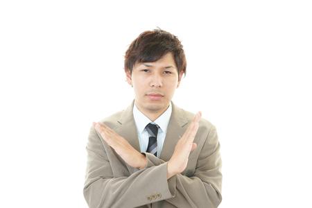 Businessman doing no good sign photo