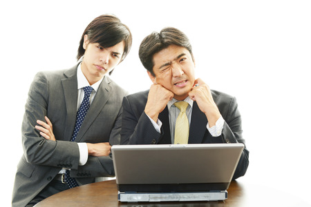 Disappointed Asian businessmen photo