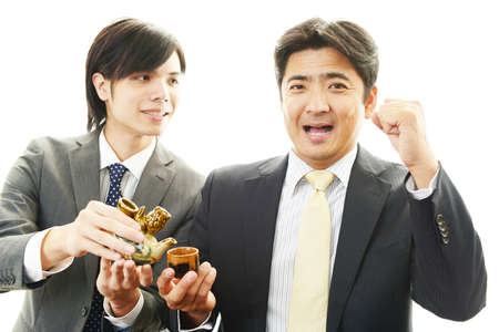 drinking alcohol: Happy Asian men drinking alcohol