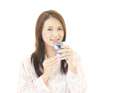 Portrait of young woman drinking water. photo