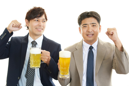 Happy Asian men drinking beer