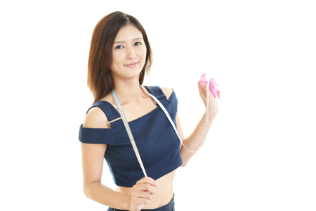 A young woman holding measure tape photo