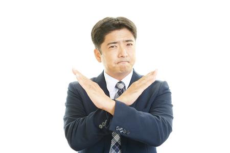 Businessman doing no good sign Stock Photo