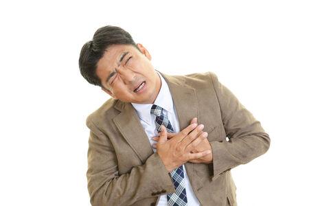 tightness: Man having a heart attack Stock Photo
