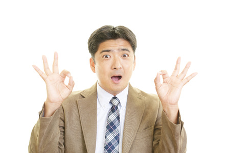 Happy businessman making ok sign photo