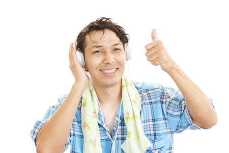 Attractive young Asian man listening to music.