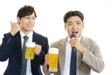 Men Singing Karaoke with Beer photo