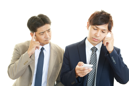 Tired and stressed Asian businessmen photo