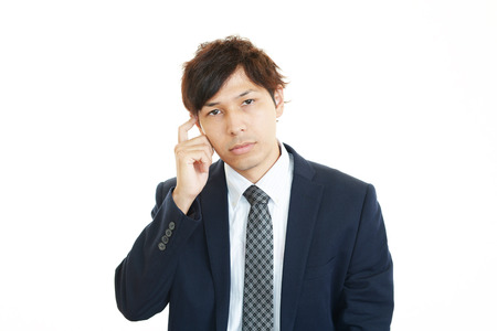 pay cuts: Portrait of businessman looking uneasy Stock Photo
