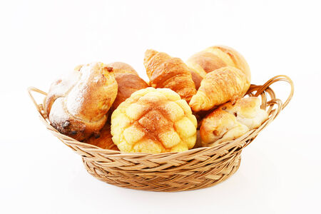 Various types of bread in a basket photo