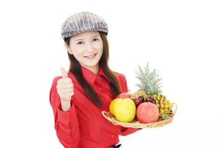 Smiling waitress holding fruits photo