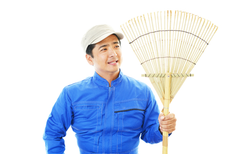 Smiling Asian janitor photo