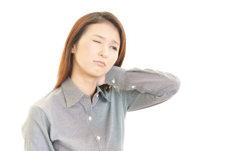 Business woman with shoulder pain. photo