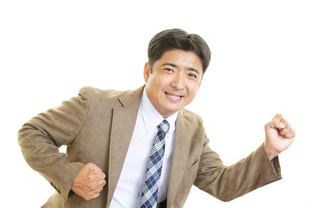 Smiling Asian businessman photo