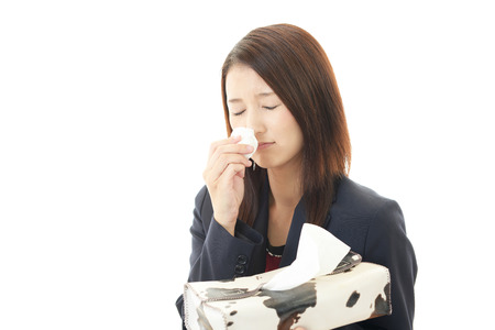 facial tissue: Sneezing woman having cold.