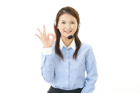 Call center operator with ok hand sign photo