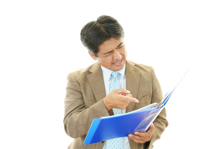 salaried worker: Tired and stressed Asian businessman