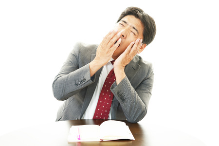 Sleepy Businessman yawning Standard-Bild