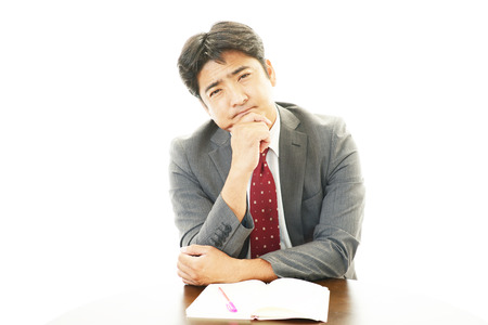 pay cuts: Tired Asian businessman