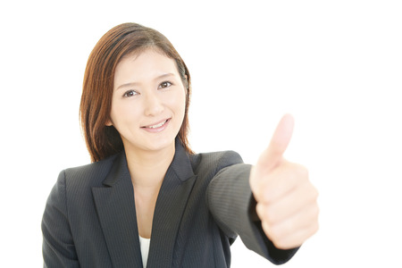Business woman showing thumbs up sign photo