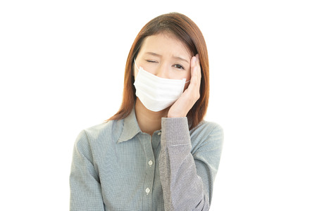tightness: Young woman with face mask having cold