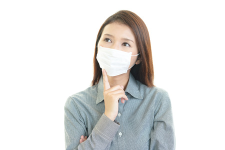 Young woman with face mask having cold photo