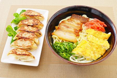 Okinawa soba with Pan fried dumplings photo