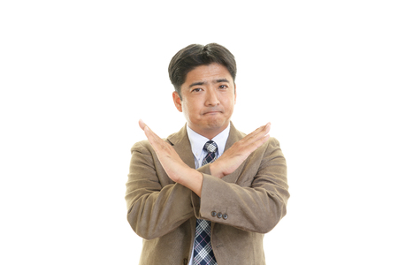 pay cuts: Businessman doing no good sign Stock Photo