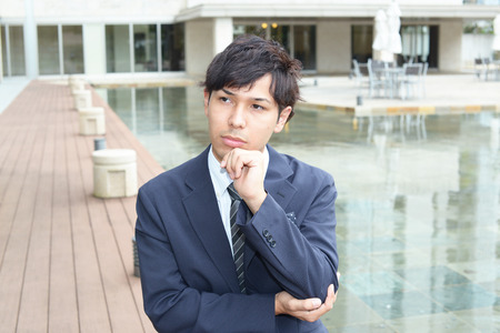 pay cuts: Depressed Asian businessman