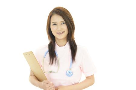 Smiling Asian female nurse photo