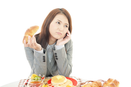 A woman with no appetite. 写真素材