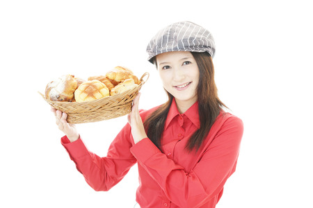 Smiling baker with breads photo