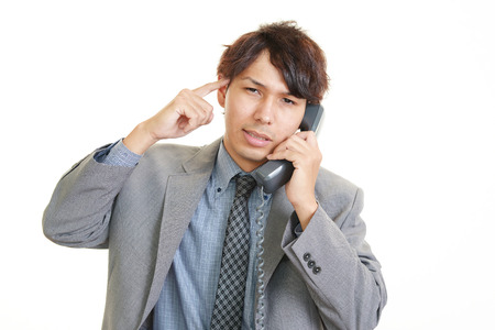pay cuts: Stressed Asian businessman Stock Photo