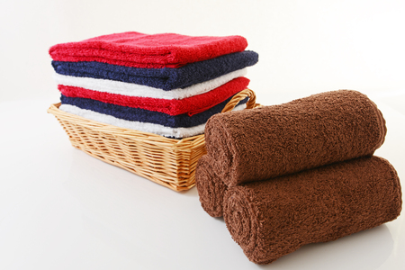 Soft and fluffy cotton towels on white photo