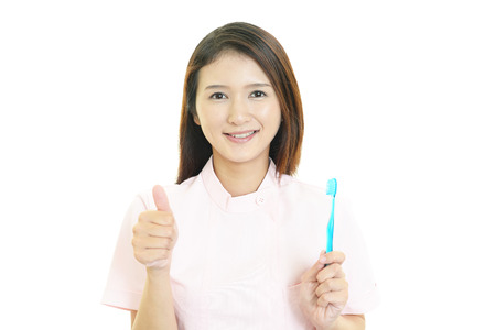 dental hygienist: Smiling dental hygienist