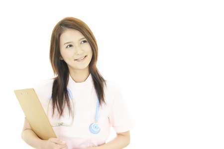 Smiling Asian female nurse photo