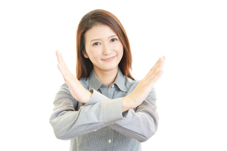 Business woman doing no good sign Stock Photo