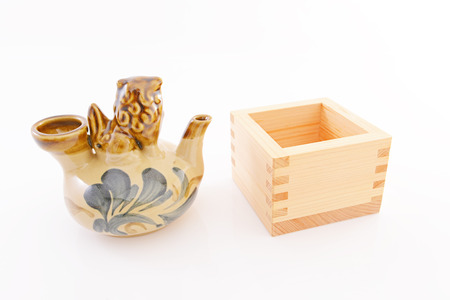 Traditional wooden box masu with sake bottle photo