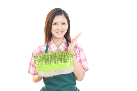 Smiling woman with vegetable photo