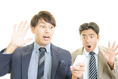 lugubrious: Surprised Asian businessmen