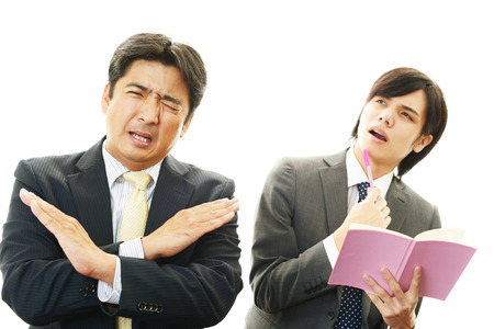 pay cuts: Disappointed Asian businessmen