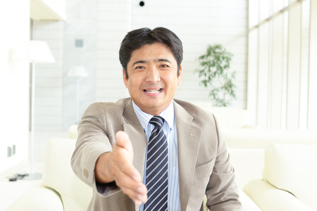 salaried worker: Smiling Asian businessman