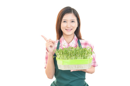 Smiling woman with vegetable