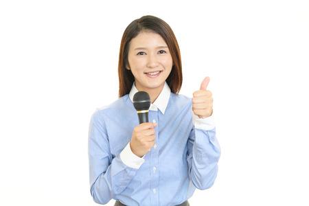 Portrait of a woman doing a presentation photo
