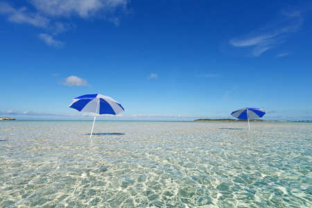 summery: The beach and the beach umbrella of midsummer. Stock Photo