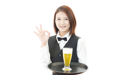 Waitress carrying beer photo