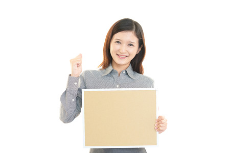 Businesswoman holding a board photo