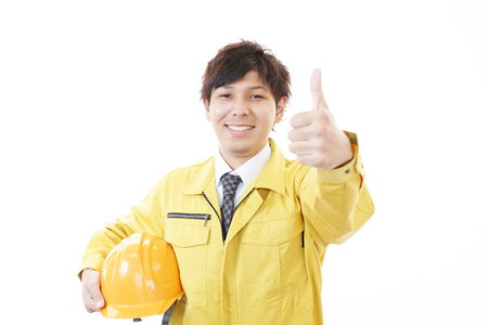 hard hat: Portrait of a worker with hard hat