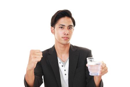 salaried: Man drinking water Stock Photo