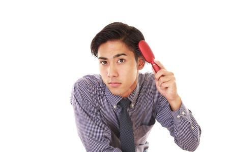 salaried worker: Man brushing his hair